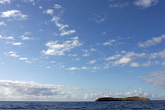 Scenic Sky over Molokini Crater. A wide angle view of the sky over Molokini crater off the coast of Maui royalty free stock photos
