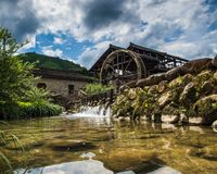 Old grain mill in the village of BaoXi, China royalty free stock photos