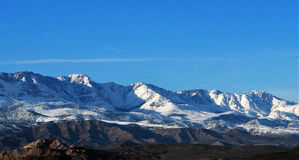 Scenic Snow Covered Mountains. Shows the shadows made by the ridges and valleys Royalty Free Stock Photos