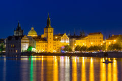Scenic spring night view of the Old Town ancient architecture and Vltava river pier in Prague, Czech Republic Stock Image