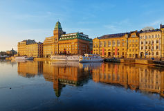 Scenic Stockholm waterfront, HDR image. Nybroviken in Stockholm with steamboats and beautiful old buildings in morning light Stock Photo