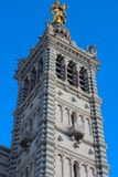 The scenic stone bell tower of Notre Dame de la Garde Basilica, Marseille, France.