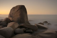 Scenic stone formation in the fog at sunset Royalty Free Stock Images