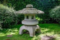 Scenic stone made arbour in Japanese Garden, Hamilton Botanical Gardens. New Zealand, North Island Royalty Free Stock Image