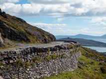 A Scenic Stone Road to Kerry, Ireland under Blue Skies Stock Photography