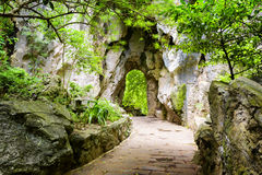 Scenic stone walkway leading to gate in rocks Royalty Free Stock Photo