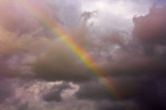 Scenic storm clouds and rainbow in the dark sky. Soft focus Stock Images