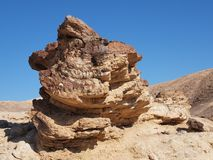 Scenic stratified orange rock in stone desert, Isr Royalty Free Stock Photo