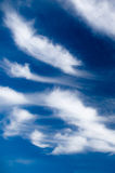 Scenic stratus clouds against deep blue sky. Natural background stock photography