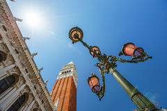 Scenic street lamp in Venice, Italy against blue sky. Venetian lantern and blue sky, Venice, Italy Royalty Free Stock Image