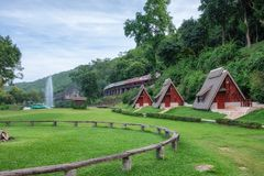 Scenic suan sai yok, river kwai cebin resort with train on histo. Ry railway of world war II in tham krasae cave, kanchanaburi, thailand Royalty Free Stock Photography