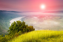 The scenic summer landscape, bend of the river at fog. Stock Photo