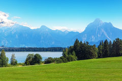 Scenic summer landscape with mountains, lake and forest Royalty Free Stock Photos