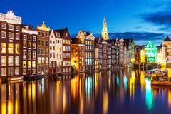 Night view of Amsterdam, Netherlands. Scenic summer night view of iconic ancient medieval buildings in the Old Town of Amsterdam, Netherlands royalty free stock photography