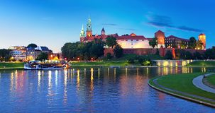 Wawel Castle, Krakow, Poland. Scenic summer night view of the Wawel Castle, Cathedral Church and Vistula river embankment in the Old Town of Krakow, Poland stock footage