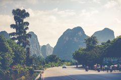 Scenic summer sunny landscape at Yangshuo County of Guilin, Chin. A. View of beautiful karst mountains Amazing green hills on blue sky background Stock Photos