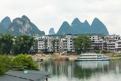 Scenic summer sunny landscape at Yangshuo County of Guilin, Chin. A. View of beautiful karst mountains and the Li River Lijiang River with azure water. Amazing Royalty Free Stock Photo