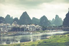 Scenic summer sunny landscape at Yangshuo County of Guilin, Chin. A. View of beautiful karst mountains and the Li River Lijiang River with azure water. Amazing Stock Photo