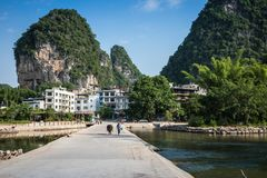 Scenic summer sunny landscape at Yangshuo County of Guilin, Chin. A. View of beautiful karst mountains Amazing green hills on blue sky background Stock Images
