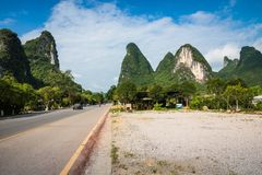 Scenic summer sunny landscape at Yangshuo County of Guilin, Chin. A. View of beautiful karst mountains Amazing green hills on blue sky background Royalty Free Stock Images