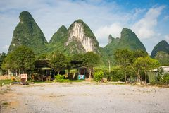 Scenic summer sunny landscape at Yangshuo County of Guilin, Chin. A. View of beautiful karst mountains Amazing green hills on blue sky background Stock Photography