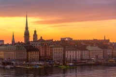Scenic summer sunset panorama of the Old Town Gamla Stan architecture in Stockholm, Sweden royalty free stock images