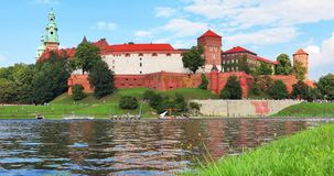 Wawel Castle and Cathedral in Krakow, Poland. Scenic summer view of the Wawel Castle fortress, Cathedral Church and Vistula river embankment in the Old Town of stock video
