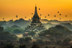 Scenic sunrise above Bagan in Myanmar. Scenic sunrise with many hot air balloons above Bagan in Myanmar. Bagan is an ancient city with thousands of historic Royalty Free Stock Photography