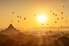 Scenic sunrise with many hot air balloons above Bagan Royalty Free Stock Image