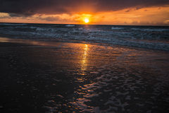 Scenic sunset and beach Stock Images