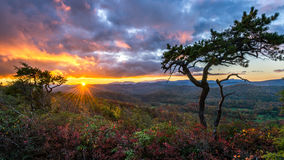 Scenic sunset, Blue Ridge Parkway, North Carolina. A dramatic sunset with fall colors along the Blue Ridge Parkway in North Carolina Stock Photos