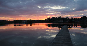 Scenic sunset lake seeon and wooden boardwalk, sunset sky Royalty Free Stock Photography