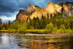 Yosemite Valley Mountains Falls, US National Parks. Scenic sunset landscape. Merced river and mountains in Yosemite Valley. Yosemite National Park, California. U royalty free stock photography