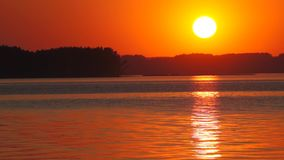 Scenic sunset over calm river stock video footage