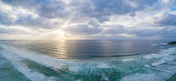 Sunset over ocean waves. Scenic sunset over ocean waves - beautiful landscape Royalty Free Stock Image