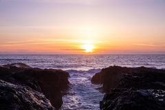 Scenic sunset over Pacific ocean and Devil`s Chasm, Oregon stock photos