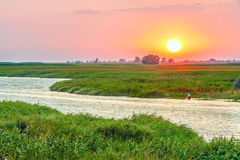 Scenic sunset over the river Stock Photo