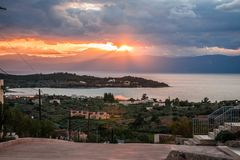 Scenic sunset over the sea in Portoheli on Peloponnese in Greece. Image of scenic sunset over the sea in Portoheli on Peloponnese in Greece stock photo