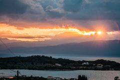 Scenic sunset over the sea in Portoheli on Peloponnese in Greece. Image of scenic sunset over the sea in Portoheli on Peloponnese in Greece royalty free stock image