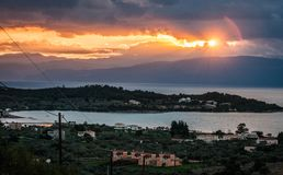 Scenic sunset over the sea in Portoheli on Peloponnese in Greece. Image of scenic sunset over the sea in Portoheli on Peloponnese in Greece royalty free stock images