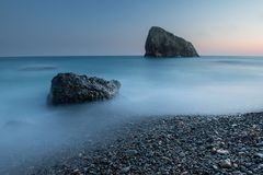 Scenic sunset on a rocky seashore on long exposure Royalty Free Stock Photos