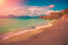 Scenic sunset seascape. Landscape with sea and sand shore. Scenic sunset seascape. Landscape with blue sea and sand shore stock photos