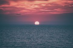 Scenic sunset seascape with sea, sun and amazing scarlet cloudy sky, travel background. Scenic sunset seascape with sea, sun and amazing scarlet cloudy sky stock photography