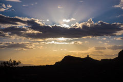 Scenic Sunset in Sedona, Arizona. Beautiful evening sun behind clouds and sandstone cliffs in Sedona, Arizona Royalty Free Stock Photo