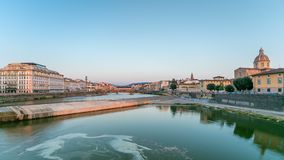 Scenic Sunset Skyline timelapse View of Tuscany City, Housing, Buildings and Ponte alla Carraia and Arno River, Florence. Scenic Sunset Skyline timelapse View of stock footage
