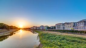 Scenic Sunset Skyline View of Tuscany City, Housing, Buildings and Arno River, Colorful sky, Florence, Italy. View from Ponte Amerigo Vespucci bridge with stock video footage