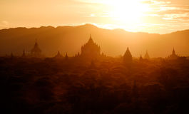 Scenic sunset view of ancient temples silhouettes in Bagan, Myan Stock Images