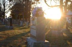 Scenic Sunsetting Graveyard Stock Photos