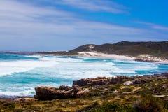 Scenic surf wave on rocky coastline. Surf wave (breaker) break on rocky coastline Royalty Free Stock Images