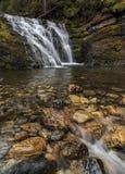 Scenic Sweetcreek Falls near Metaline, Washington. Water flows over rocks at lower Sweetcreek Falls, near Metaline, Washington Stock Photos